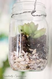 fill a mason jar with mini shells potting soil and a succulent adore diy hanging mason jar