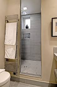 the ample shower room displays a large countertop made of light and dark grey stoneware tileshand wash basin is made of stone ample shower room