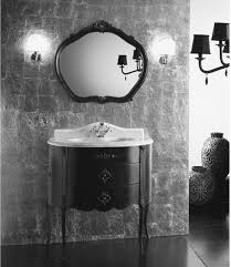 modern italian bathroom furniture ideas with black wooden framed wall mirror having carved accent on gray bathroom accent furniture