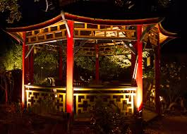 the homeowners wanted to create a magical nighttime getaway in their asian inspired landscape asian inspired lighting