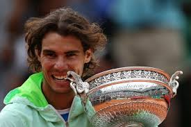 Rafael Nadal completed his charge on Roland Garros to regain his title and hoist the Coupe de Mousquetaires for the fifth time in his young career. - Rafael_Nadal_Roland_Garros_trophy