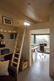 they split the office ceiling into a loft bedroom space very efficientbeis midrashid personally like the office space to be either a art studio andei studio italia design