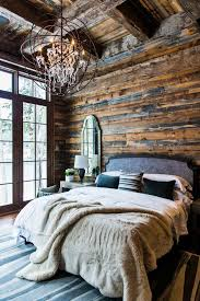 make a cabin bedroom luxe with fuzzy throws and a chandelier for a modern rustic vibe brilliant 12 elegant rustic