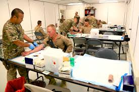u s department of defense photo essay u s sailors draw blood from u s marines during a walking blood bank on camp leatherneck in