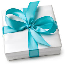 lttle white gift box with blue ribbon