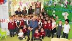 Primary pupils meet the children's author their classed is named after