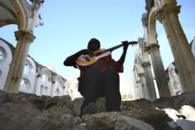 c easter holy week playing guitar in ruined cathedral in port au a photo essay a point of unity holy week and easter as seen by russian eyes 02c easter holy week playing guitar in ruined cathedral in port au prince