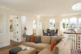 beige couch living room contemporary with arched windows beige dining area french doors gray ivory orange beige sectional living room