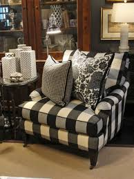covered in a classic black and white buffalo check this chair is relaxed black white furniture