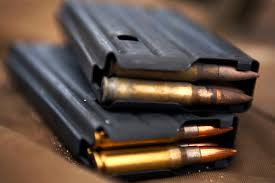 weapons training essay magazines of mm ammunition lay atop a firing mat during marksmanship and observer training on