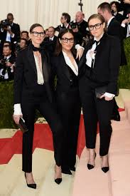 hillary clinton s dnc look and the return of the power pantsuit in suited up jenna lyons jenni konner and lena dunham at the 2016 met gala photo jamie mccarthy filmmagic
