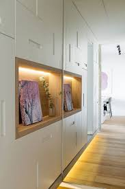 view in gallery wooden niches surrounded by bespoke cabinets at the entrance of the apartment bespoke furniture space saving furniture wooden
