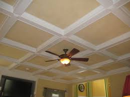 coffered ceiling in cream and white with lowes ceiling fan plus light matched with yellow wall baseboards ceiling fan