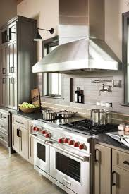 restaurant kitchen faucet small house: a small niche behind the stove is a great place for oils and spices and
