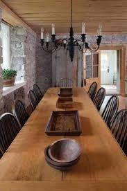 long wood dining table: extra long dining table carved wooden bowls chandelier