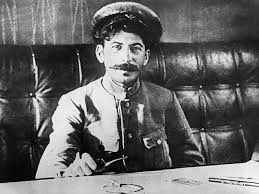 vintage everyday top facts you didn t know about joseph stalin joseph stalin sitting at a table in 1918