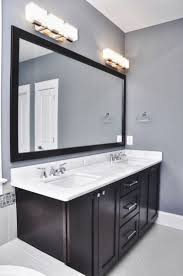 bathroom grey wall and dark cabinet with bathroom light fixtures over mirror awesome sample pendant lights bathroom