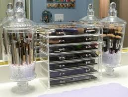 plastic makeup organizer put bathroom: chic plastic drawer and glass jars with lids for makeup organizers in the bathroom