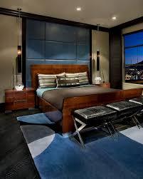 bedroom cool masculine bedroom furniture wooden kingsize bed black leather end bed stool blue pattern rug bedroom furniture guys bedroom cool