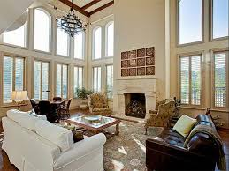 glamorous living room decor ideas with round chandelier for high ceiling over white and black sofa also fireplace in european living room designs amazing living room decorating ideas glamorous decorated