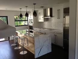 calacatta marble kitchen waterfall: marble waterfall island contemporary kitchen contemporary kitchen marble waterfall island contemporary kitchen