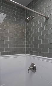 bathroom shower tile repair gray glass subway tile paired with traditional white subways below