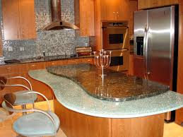 kitchen backsplash stainless steel tiles: remarkable stainless steel mosaic tile backsplash with cool granite countertop ideas feat wooden cabinets also attractive