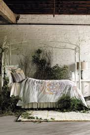 kitty otoole elegant whimsical bedroom: ive always loved this wrought iron bed again love the brick and floors the plants creeping out from under make a great photo but realistically