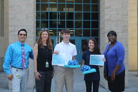 battery creek high essay winners the island news beaufort sc from left to right gil sanchez assistant principal mrs jill mcnamara