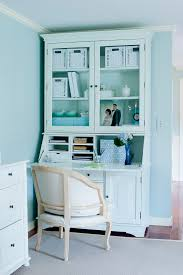 secretary desk with hutch with light blue walls blue office walls