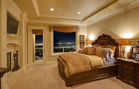 big master bedrooms couch bedroom fireplace: luxury bedroom with fireplace tv balcony access with city views and large wood bedroom