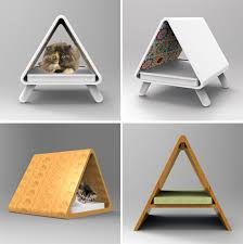 the line includes a few different cat bedhideaway designs one with a scratching surface on the side as well as some wall hanging hideaways that look like cat modern furniture