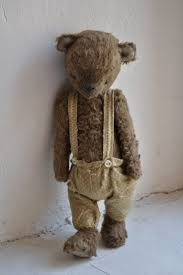 old teddy...was worn' bare'! the twins slept together with him until ...