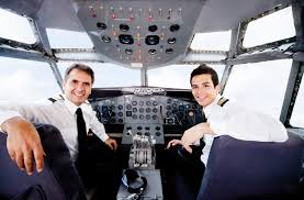 unique career opportunities for travel lovers pilots sitting in an airplane cabin flying and smiling