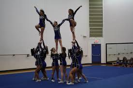 photo essay dhs cheer showcase 3 13 2015 q3 lauren haverlock the varsity cheer team performs a double liberty pyramid