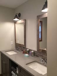 adding new wall mount light fixtures from home depot along with recessed lighting for ample light highlights each rustic mirror and makes this wall a ample shower lighting