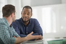 tips for successful teamwork two men resolve a conflict at work by using personal courage to resolve it