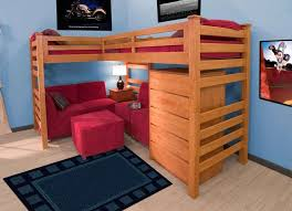 place red sofas and ottoman under simple oak toddler bunk beds with red bedding children bunk beds safety