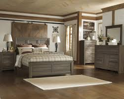 bedroom set main: juararo collection  piece aged brown sawn finish queen panel bed bedroom set main image