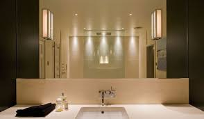 bathroom box image of light box sconce attached on plain wall paint of modern bathroom decorations with bath