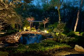 landscape lighting brings out the colors textures and beauty of your trees shrubs flower beds and garden at night area lighting flower bed