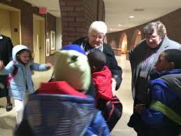 Union East second graders hug the sisters as they arrive for the after school program  WBFO