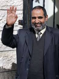 Abu Laila, Khalil. Senior Hamas leader Khalil Abu Laila waves outside his house in Gaza February 16, 2006. REUTERS/Mohammed Salem - abulaila