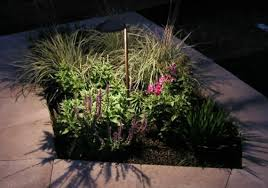 path light in flower bed by natural reflections green outdoor lighting area lighting flower bed