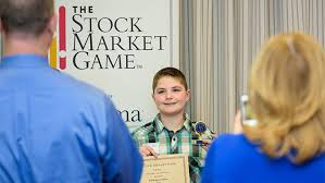 stock market game winners   udailynicholas gaskins celebrates a stock market game victory