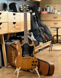 <b>Электрогитара Gibson SG Tribute</b> Natural Walnut, с чехлом