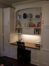 attractive white built in desk ideas also natural brown wooden desk counterop also dark brown study chair also white bookcase and ornament shelves built bookcase desk ideas