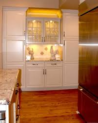 kitchen lighting above kitchen cabinet lighting ideas with diamond pattern backsplash and vintage ceramic rooster figurine above kitchen cabinet lighting