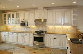 painted kitchen cabinets vintage cream: image of vintage cream kitchen cabinets with chocolate glaze