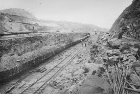 canal essay steam shovels load rocks blasted away onto twin tracks that remove the earth from the
